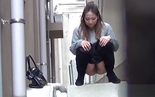 Asian babes piss in all directions in someone's bailiwick